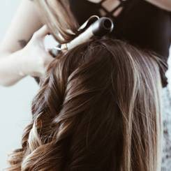 Curling Hair with Curling Iron.